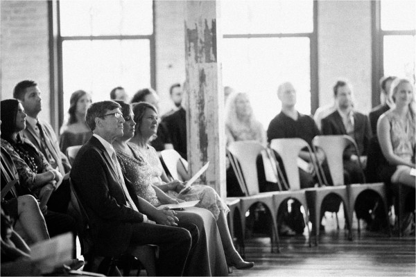 Journeyman Distillery Wedding by Tifani Lyn Photography // Wedding Ceremony // Industrial warehouse wedding venue located in Three Oaks, Michigan ( West Michigan ). The venue features hardwood floors, brick, rustic metal and string lights galore.