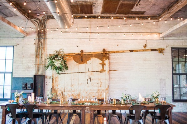 Journeyman Distillery Wedding by Tifani Lyn Photography // Industrial warehouse wedding venue located in Three Oaks, Michigan ( West Michigan ). The venue features hardwood floors, brick, rustic metal and string lights galore.